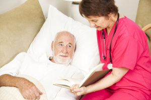 nurse assisting an old man